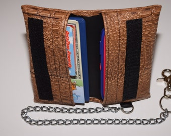 Handcrafted, multi-use, universal fit cell phone and wallet with chain. Made for a variety of cell phones with or without an otterbox.