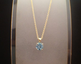 14k gold chain + pendant gold round 4 prong with gem or diamond setting.  blue topaz, smoky quartz,amethyst ,citrine