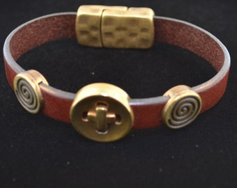 Brown lather bracelet with brass designs