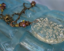 Vintage style resin real queen anne's lace and lampwork glass bead necklace.