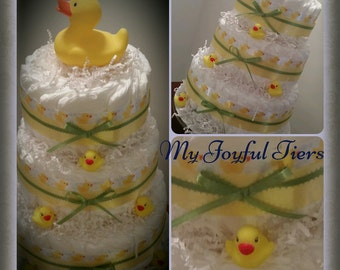 Rubber duck diaper cake. Yellow rubber duck perfect for baby shower baby gift or 1st birthday gift.  Light up rubber duck on top. Free ship