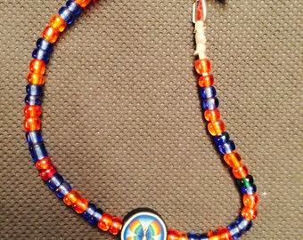 Orange and Blue glass bead bracelet with Rainbow Butterfly focal