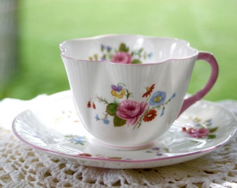 "Vintage Shelley Dainty ""Rose & Red Daisy"" Tea Cup and Saucer: White with Flowers and Pink Trim."