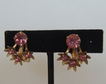 Gold tone and pink rhinestone floral clip earrings