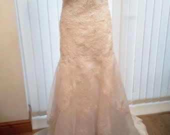 Bespoke lace mermaid wedding dress
