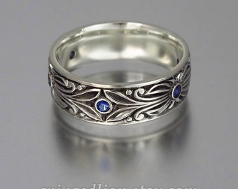 The COUNT mens wedding band in 14K white gold with Blue Sapphires