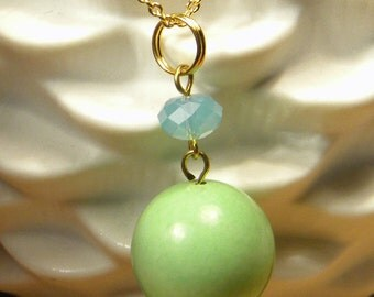 Green, chalk turquoise, vintage bead pendant necklace on a gold plated chain