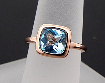AAA Swiss Blue Topaz   7x7mm  1.45 Carats   Cushion Cut in a 14K Rose gold Engagement solitaire ring. m