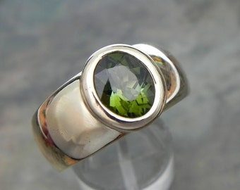AAAA Green Tourmaline   10x8mm  3.01 Carats   14K yellow gold ring