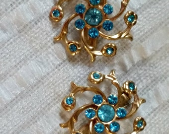 1950s Vintage Scatter Pins, aqua rhinestone in gold tone galaxy spiral, pair