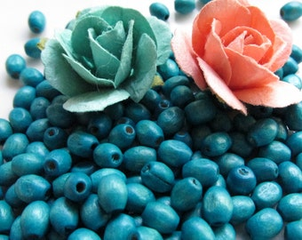 Wooden Teal Oval Rice Beads 6mm by 4mm 8 inches (20cm)