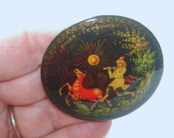 Vintage Russian Signed  Kohek Topeyhok Jewelry Hand Painted Deer and Flute Player Brooch