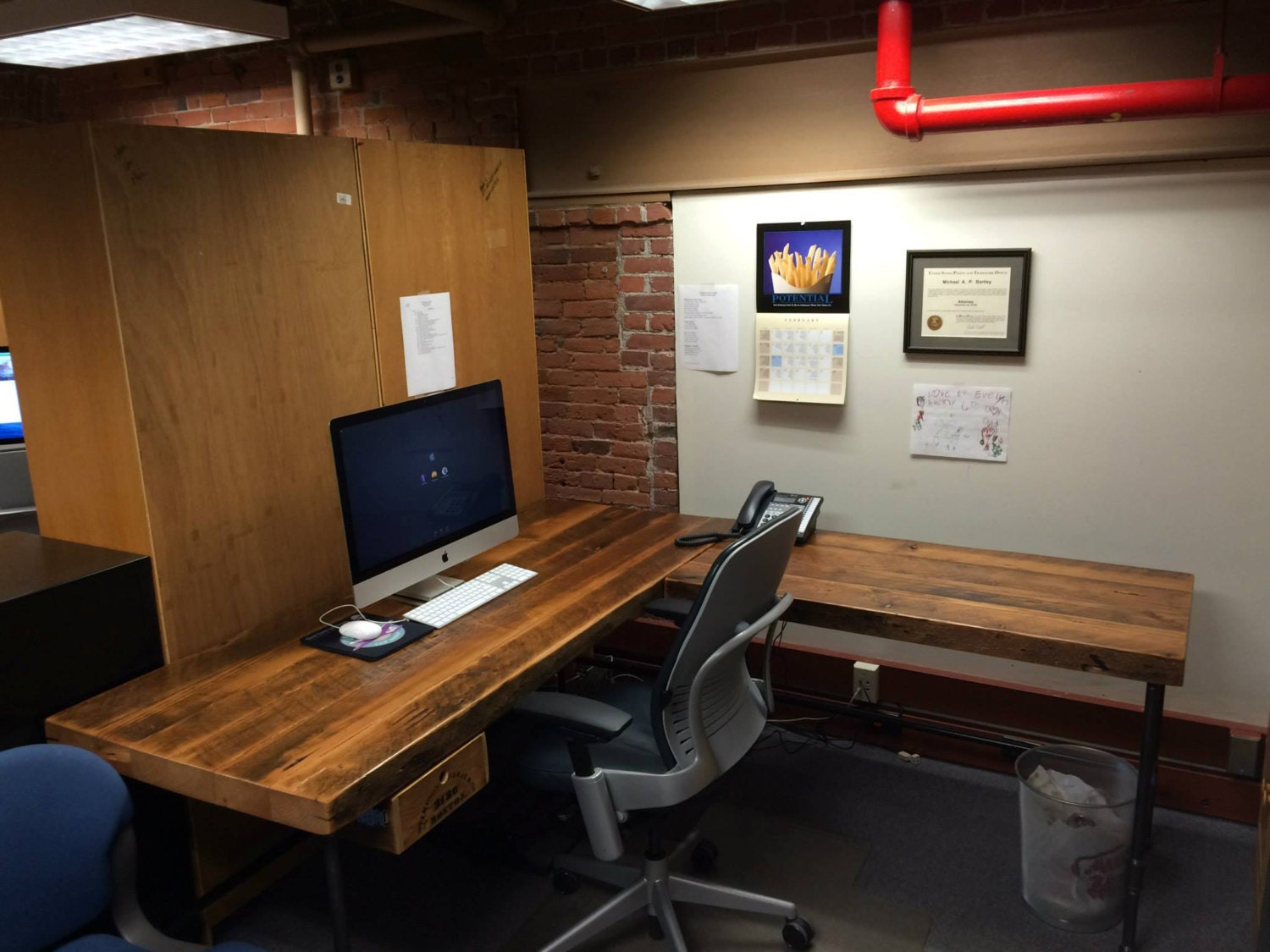 Solid reclaimed wood desk with Iron pipe legs in by UrbanWoodGoods