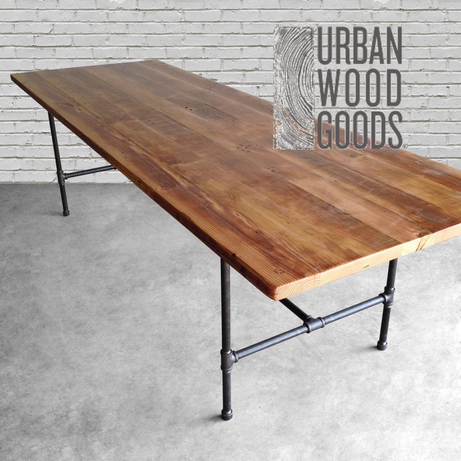 wood dining table with reclaimed wood top and iron pipe legs. Black Bedroom Furniture Sets. Home Design Ideas