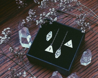A pair of two odd earrings. Bespoke, Custom (sterling silver, your choices of shape, length & stamp - rune, moon, triangle, ankh, arrow...)
