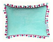 Aqua cushion with aqua and pink pompom tassel trim 30cm x 40cm