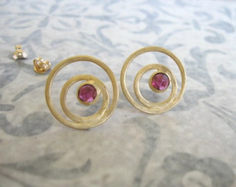 Gold circle stud earrings with Garnet , Gold post earrings , Gemstone  studs , Handmade by Adi Yesod