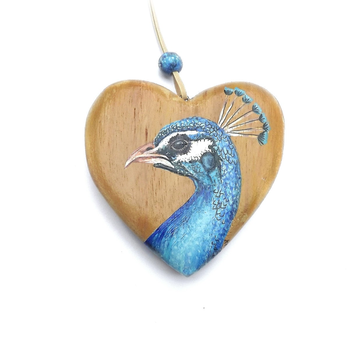 Peacock heart a wooden ornament painted with