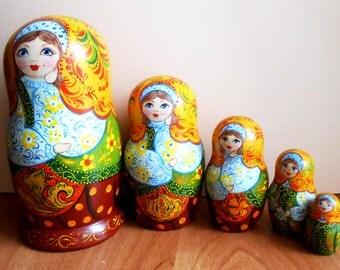 Nesting dolls (matryoshka) in Russian style khokhloma  handmade