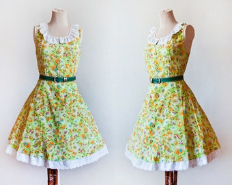 Green and Orange Sleevless Flroal Print Dress With White Lace Decoratiion