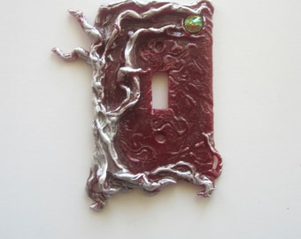 The One Tree switch plate, Silver and Red