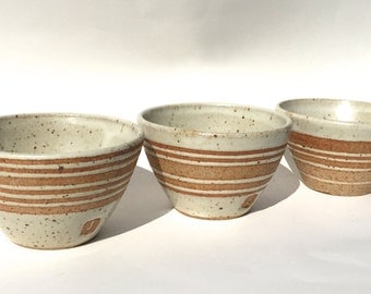 Set of three hand thrown ceramic white striped bowls