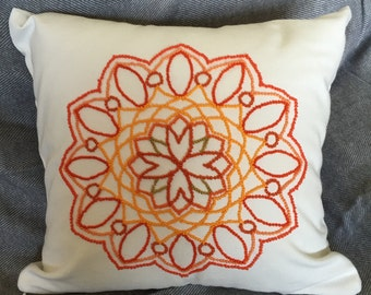 Mandala cushion cover. Hand embroidered. Shades of orange.