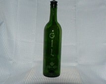 Recycled etched bottle for olive oil with flip top.