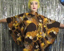 Vintage psychedlic brown yellow orange and white flower abstract hippie poncho shirt blouse from the 70s with tie on the back