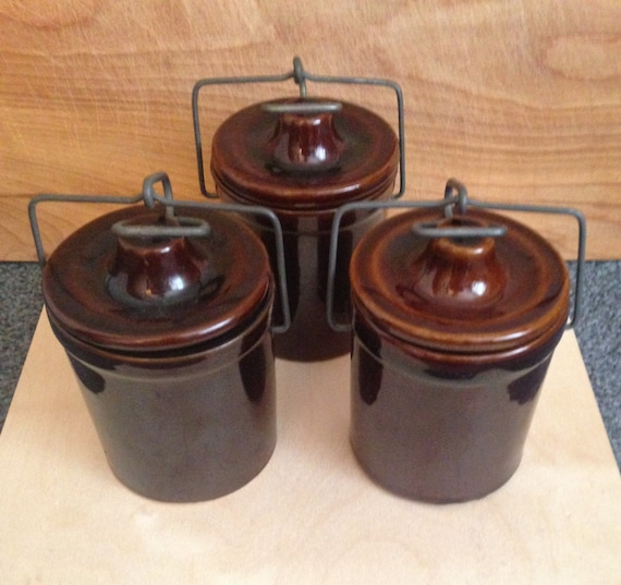 set of three brown ceramic canisters kitchen by
