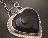 Carved Rainbow obsidian swirl heart statement necklace with a blue flash labradorite accent