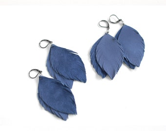 Suede or leather feather earrings in blue.