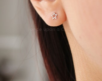 Cute little open star stud earrings in sterling silver 925