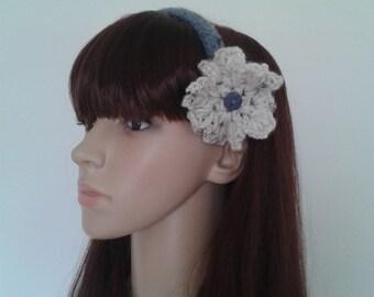 Crochet headband with a ecru flower.