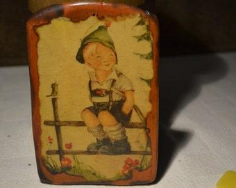 "Hummel / Boy / sitting on a fence / decoupaged / wood. 5.5"" x 3.75"" / fence / decoupaged Hummel / art / Hummel art / children / home decor"