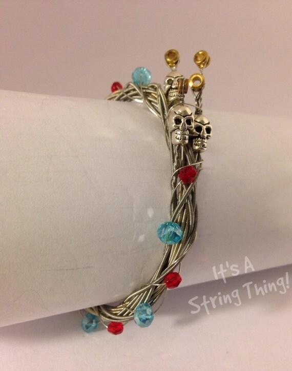 guitar string bracelet with metal skull by allaboutthestrings. Black Bedroom Furniture Sets. Home Design Ideas
