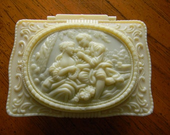 Ivory Plastic Victorian Style, Hinged, Man and Woman on Top, Mirrored Inside, on Legs