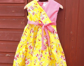 Girls' clothing, girls' dress in yellow and coral flower/spot print