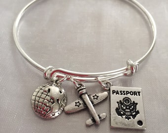 Traveler-Bracelet with passport, airplane and world for the world traveler