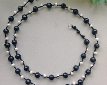 Knotted onyx and pearl necklace