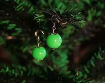 Earrings, winter apples, green apples.