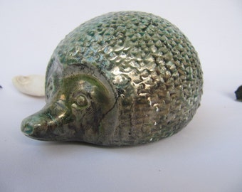 ceramic hedgehog,slipcaste with turquoise glaze,raku fired which creates unexpected effects