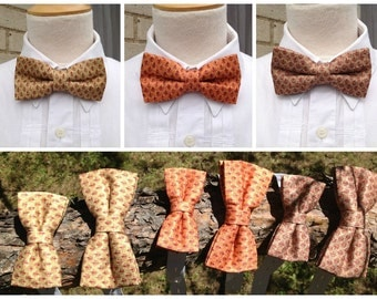 green or orange or brown bow tie duo with small red detail