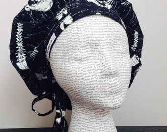 Bouffant Surgical Scrub Cap with Ties feturing black fabric with labeled human skeleton GLOWS IN DARK