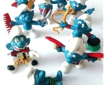cake toppers 9 smurf figures 1970s but look as if made yesterday .Top condition great for collectors fans a rare lot bundle of figures
