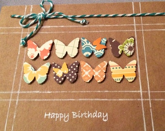 Butterflies Lined up to Wish you A Happy Birthday on Brown Kraft Paper