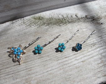 Turquoise colored flowers with butterfly bobby pins ( set of 4 ) made by CMS