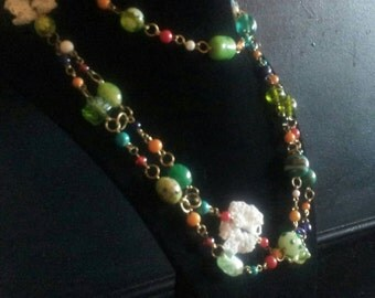 Designer glass bead with little crochet flowers necklace