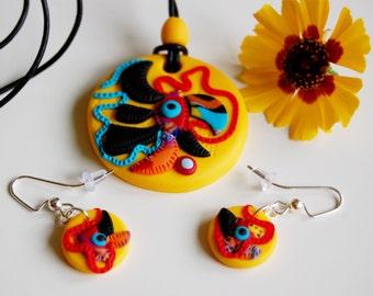 Yellow pendant with earrings