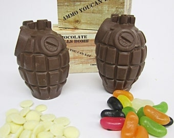Two milk chocolate hand grenades with white buttons and jelly beans